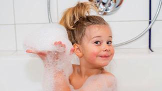 happy little girl in a bubble bath
