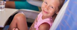 Little girl smiling on plane