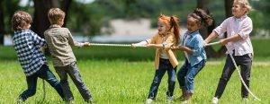 Kids playing tug of war outside